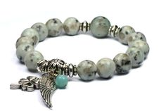 Check out this item in my Etsy shop https://www.etsy.com/listing/154776014/kiwi-jasper-with-angel-wing-amazonite