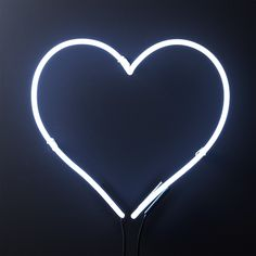 "Shop Loves Neon White. ""Love one another,"" has been the optimistic ethos of Fred Segal since forever. Now you can bring that bright feeling home in heart-shaped neon. Adds a little artsy-whimsy to any room. Hang alone or in multiples."