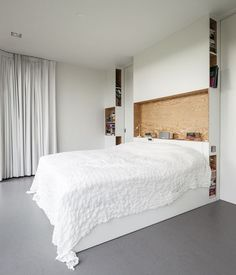 HEADBOARD DESIGN IDEA - Include A Built-In Shelf // Holding books, a speaker, lights, and a clock, this built-in shelf shows just how handy having one right right above your bed can be.