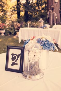 Guest table centerpiece from our Peter Pan themed backyard wedding stylized photoshoot