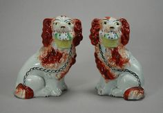 Pair Staffordshire pottery figures of spaniel dogs with baskets Victorian period...
