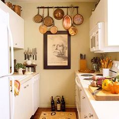 small spaces kitchen - the decorative pans are a nice touch for that back wall