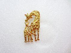 Gold giraffe pin giraffe brooch gold tone by TreasureTrovebyTish, $7.42