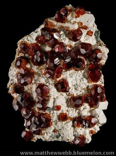 exclusiveminerals > Great mineral specimens in other collections > Spessartine on orthoclase