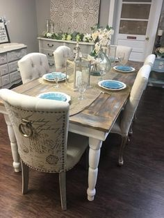 Beautiful farmhouse table seats up to eight depending on chair size. Table top lightly painted in mix of white, gray and natural wood tones. A great piece to