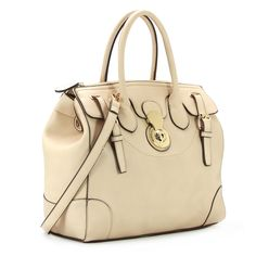 Tote your belongings in style with this gorgeous faux leather tote bag. Featuring buckle strap details, light goldtone hardware, a front lock, and a detachable, adjustable shoulder strap this roomy tote has it all.