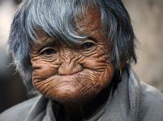 An elderly Bhutanese woman sits outside her home in a village near the town of Haa. The Haa valley lies along the western border of Bhutan and to the north it is bounded by the Tibet autonomous region of China. The valley was off-limits to tourists until 2002