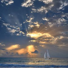 sailboat in sunset on sea...