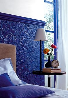 Paint over 3D wall paper for this awesome effect. A little too blue for me but great idea.
