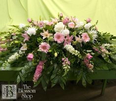 Pink and white casket spray by The Blossom Shop - Charlotte, NC.