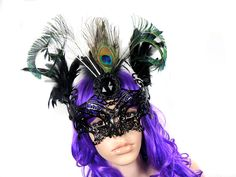 One of my selfmade venetian masks with different kinds of feathers.  Available in my shops:    http://www.etsy.com/shop/NinielChan    http://de.dawanda.com/shop/DeadDoll