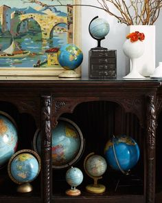 ) against the fun globe collection. Console may be from a church (even better! Via Design*Sponge. World Globe Map, World Globes, Map Globe, Globe Art, Vintage Maps, Globes Terrestres, Charles Eames, We Are The World, Interiors