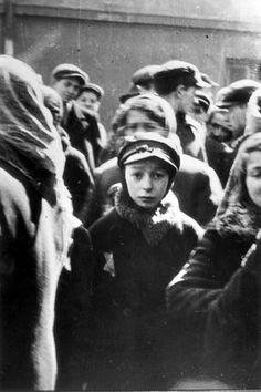 Lodz, Poland, 1941, Benjamin Fortonsky in a ghetto street. Mendel Grossman