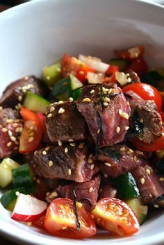 This seared beef poke recipe is a meaty twist on the Hawaiian classic using seared beef fillet, ginger and chilli. A great starter for meat-lovers.