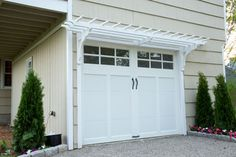 Use milled brackets and pressure-treated lumber to create an elegant canopy over your garage door | Photo: Kolin Smith