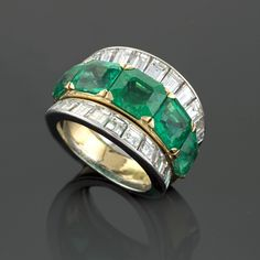 An Estate platinum and 18 karat gold ring with emeralds and diamonds by Van Cleef & Arpels.  Circa 1970.  Available exclusively at Macklowe Gallery.