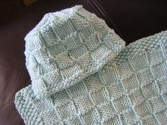 I made a checkerboard baby blanket, but alas, I wanted a matching hat. Voila'! ENJOY!