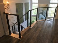 Welsh cable railing - modern cable railing with steel posts and stainless steel cables and wood handrail fabricated and installed by Capozzoli Stairworks. Contact: website: www. Stainless Steel Cable Railing, Wood Handrail, Cherry Hill, Welsh, Contemporary, Modern, Windows, Posts, Website
