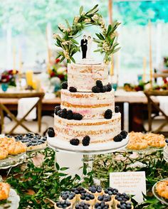 Cocoa & Fig finished this gluten-free almond naked cake with a sprinkling of blackberries, while the couple added an heirloom cake topper.