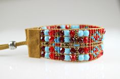 An outfit is never complete without some finishing touches and this beaded boho bracelet will top off just about any outfit. Beautifully hand-crafted from quality materials, this bohemian style bracelet is sure to be noticed and stand the test of time. A medley of decadent red and