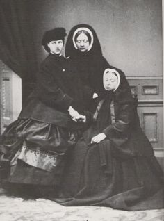Oh do I geek out when I find a picture I haven't seen before. Princess Alexandra of Wales, a lady-in-waiting, Queen Victoria, in mourning for Prince Albert, 1862.