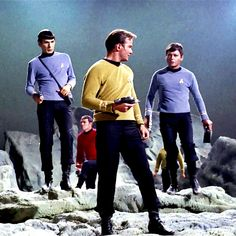 Spock, Kirk, McCoy, a red-shirt... and possibly Chekov in the background, but I'd have to re-watch this particular episode to be sure.