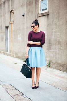 Purple-wine quilted top & cool blue skirt. So cute.
