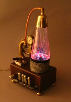 Steampunk Plasma Aether Charging system...I have one of these plasma balls in my garage. This gives me ideas!