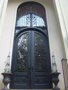 Yep!  This INCREDIBLE, wrought iron front door with transom is one of ours!  Common'... you know you want to pin it for your dream home... iron doors.  entry door.  dream home.