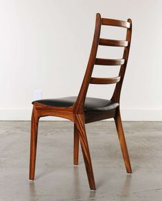 Set of 8 Rosewood & Leather Dining Chairs, Kai Kristiansen, Denmark   From a unique collection of antique and modern dining room chairs at http://www.1stdibs.com/furniture/seating/dining-room-chairs/