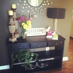 this is exactly what i'm looking for in my foyer (the table)