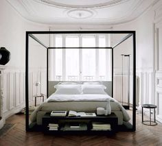 Bed Alcova by BB Italia, a canopy bed design with contemporary lines and beautiful positioning of the poles.