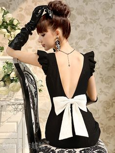 Black dress with white bow at mid-back