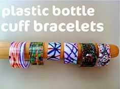 Bracelets made from recycled bottles, t-shirt fabric, marker & glue.