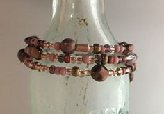 Wrap style, Pink/brass tone Czech beads, handcrafted charms.