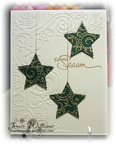 """I used a stamp of a Christmas tree from Flourished and stamped it three times with Versamark ink and embossed with gold embossing powder and then used a Nestie to cut the stars. The sentiment is from PTI also embossed in gold."""