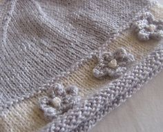 Ravelry: pwa's pattern 'pearl'  ~ hat for a baby girl ....... this is just darling