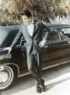 Elvis and the 1967 Lincoln Executive Limousine given to him by Colonel Tom Parker.