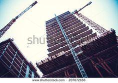 Crane and building construction. big building construction - stock photo