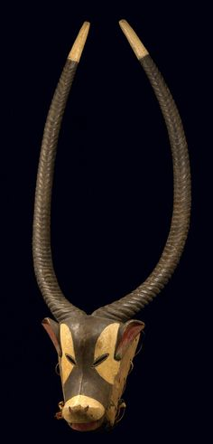 Africa | Antelope mask from the Guro people of Ivory Coast | Woo, matt patina, polychrome paint and horns