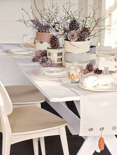 Winter Table Decorations     Top your table with cottage charm using a few affordable ingredients: jute twine, drop cloth, clothespins, and paint.