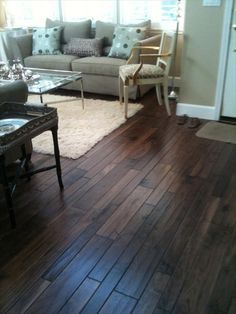 Thin plank dark wood floors , this is what our restain will look like