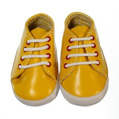 Bright and funky pre-walker sneaker for boys. Bright yellow colour with yellow and white chequered lining. Red rims on shoe lace holes and white laces. Sneakers are ankle high with a non-slip sole to provide grip to surfaces if your little one crawls, stands or takes a couple of steps. Shoes are made of material and a soft sole making the shoes lightweight and easy to wear.  Price: $29.50  http://www.bubbaboosh.com.au/boys-shoes/Logan