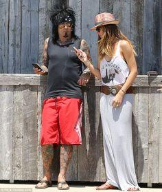 Beachin  Nikki Sixx and his beautiful wife Courtney.