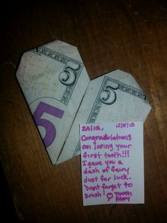 Tooth Fairy Idea: Used a youtube tutorial for making a money origami heart, sprayed with glittery hair spray, and added a tiny tooth fairy note!