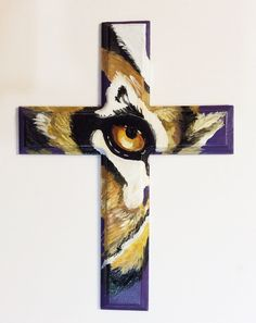 Lagniappe Frame Shoppe and Fleur deSign Studio - Hand Painted Tiger Eye Cross, $125.00 (http://stores.laframes.com/hand-painted-tiger-eye-cross/)