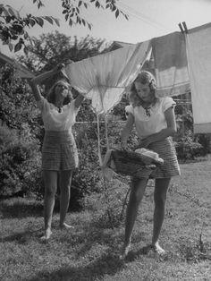 Teenage girls hanging laundry