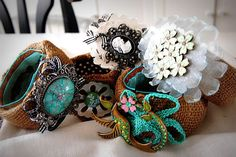 Repurposing old cuffs with burlap and and vintage broaches.