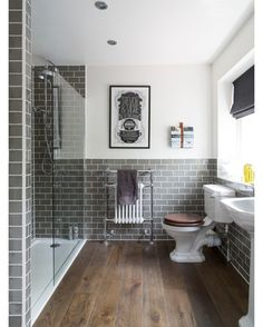 Buckinghamshire Full House Refurbishment - Design ideas for a traditional bathroom in South East with a pedestal sink an alcove shower a two-piece toilet gray tile subway tile white walls and dark hardwood floors.  #bath #bathroompic #bathtub #bathdesign #design #bathroom #bathdecor #bathroomdesign #bathfaucet #bathideas #bathinspiration #luxurybath #bathroomdecor #bathdesignideas #dreambath #dreambathroom by magnus_design