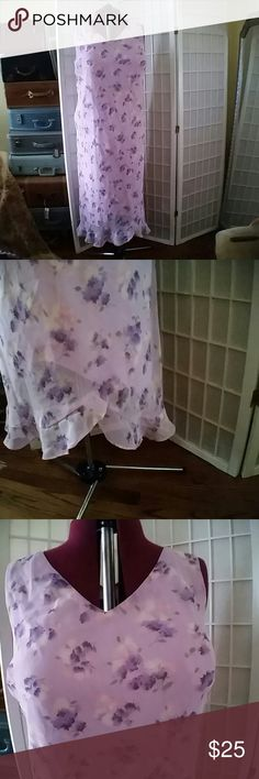 Watercolor Purple and Pink Floral Dress Dully lined chiffon watercolor Purple and Pink Floral dress with vintage neck tank top and asymmetrical ruffle hem.  I love this dress. I literally wear it in the winter with a chunky knit sweater, cardigans in the spring, with a purple Blazer to work and as pictured all summer. I have always dry cleaned it to keep it like new. Sadly my hips do not lie, it no longer fits..   Plus note it runs big, 60 inches shoulder to hem and 56inch waist, the back is…